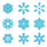 Set of blue snowflakes on white Stock Photography