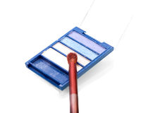 Set of blue-tint eyeshadows with a brush Royalty Free Stock Images