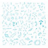 Set of blue vector hand drawn arrows. Vector hand drawn arrows set written with blue ink on paper Royalty Free Stock Images