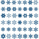 Set of blue vector snowflakes on a white background stock illustration