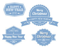 Set of blue vintage retro Christmas labels. Collection of blue vintage retro Christmas labels with white lettering Stock Photo
