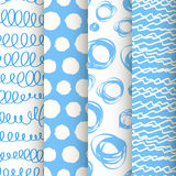 Set of 4 blue and white doodle seamless patterns Royalty Free Stock Photo