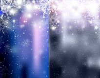 Set of blurred blue and silver Christmas winter backgrounds with sparkles and snowflakes. Vector background for your creativity Royalty Free Stock Photo