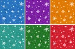 Set Bożenarodzeniowi bezszwowi wzory z płatkami śniegu Na barwionych tło Fotografia Royalty Free