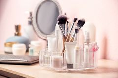 Set of body care cosmetic products on dressing table. Space for text royalty free stock photography