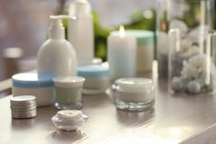 Set of body care cosmetics. On table stock photos
