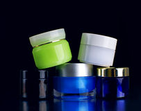 Set of body creams. Over dark Royalty Free Stock Images