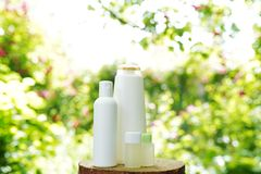 Set of body skin care products on nature background, copy space. Shampoo, gel, oil stock photos