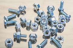 Set of bolts and tools on mirror surface Royalty Free Stock Image