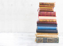 Set of books. Tower of books on white wooden desktop stock photography
