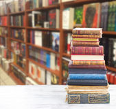 Set of books. Tower of books on white wooden desktop in bookstore stock photo
