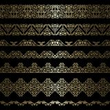 Set of borders. Set of gold borders on black background Stock Photography