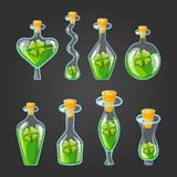 Set with bottles of clover potion Stock Image