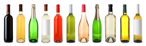 Set of bottles with different drinks. On white background royalty free stock photo