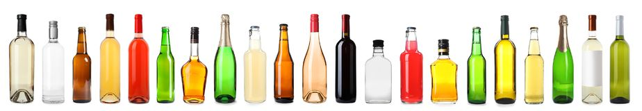 Set of bottles with different drinks. On white background stock photography