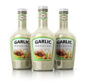 Set of bottles with garlic dressing Stock Photos