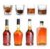 Set of bottles and glasses with expensive whiskey. On white background stock photos