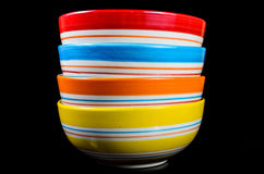 Set of bowl with black surface background. Colorful stock image