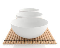 Set of bowls on bamboo Royalty Free Stock Photography