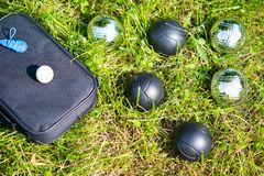 Set of bowls for playing bocce on a green lawn stock photography