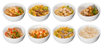 Set of bowls with rice meat seafood and sesame isolated on white Stock Image