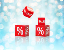 Set of boxes with sale and percent sign. Shopping, retail, discount, advertisement and consumerism concept - set of boxes with sale and percent sign over blue Stock Photos
