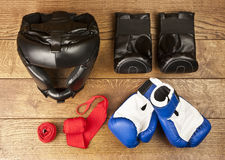 Set of boxing equipment on a wooden background Stock Photography