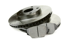 Set of brake discs and pads. Front brake discs and two brake pads Royalty Free Stock Images