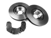 Set of brake discs and pads. Stock Photos