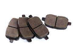 Set of brake pads, car spares isolated on white background. Set of old brake pads, car spares isolated on white background royalty free stock photography