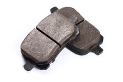 Set of brake pads, car spares isolated on white background. Set of old brake pads, car spares isolated on white background royalty free stock images