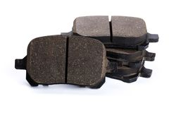 Set of brake pads, car spares isolated on white background. Set of old brake pads, car spares isolated on white background royalty free stock photo