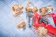 Set of brass hardware on channeled metal plate plumbing concept Stock Photos