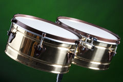 Set of Brass Timbales Isolated on Green Royalty Free Stock Image