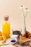 Set for breakfast: black coffee, milk, toast with jam, orange ju Stock Images