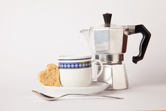 Set breakfast. Cup of coffee with heart butter biscuit and coffee maker Royalty Free Stock Photo