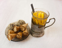 Set for breakfast - pastries, a cup of tea Stock Photos