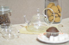 A set breakfast table. Round glass kettle, two cups, muffin, sugar, a can of coffee Royalty Free Stock Photography