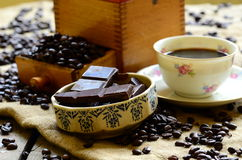 Set of breaking time coffee with coffee mill and pieces of chocolate Stock Photos