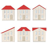 Set of brick houses with different red tile roofs Stock Photos