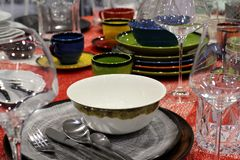 Set of bright beautiful dishes and glasses on the table stock photo