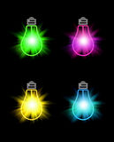 Set of bright color bulbs. On black background Royalty Free Stock Photos