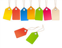 Set of bright colored price tags on a cord. On a white background, vector Stock Photos