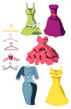 Set of bright dresses and coat racks Stock Images