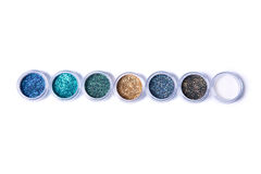 Set of bright glitters in jars Stock Image