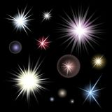 Set of bright glowing colorful stars burst on black background. Glitter suns effect decoration with ray sparkles for your design. Abstract night sky objects Stock Images