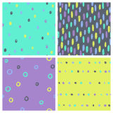 Set of bright paint drops seamless patterns. Stock Image