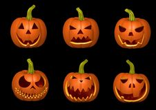 Set of bright pumpkins on a black background. Halloween royalty free stock images