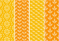 Set of bright seamless patterns with wheat ears. Orange and yell Royalty Free Stock Photos