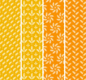 Set of bright seamless patterns with wheat ears. Orange and yell Royalty Free Stock Photo
